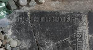 Floor slab of Adriaen van Wijngaarde and [...] Tielmand[r. ...]: detail of inscription on lower edge