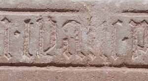 Sarcophagus lid(?); floor slab of Tja[...]e, wife of Peter Banister, and possibly another person; detail first name
